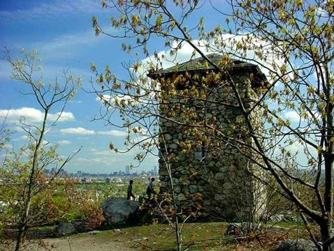 A photo of a square stone tower (Wright's Tower)