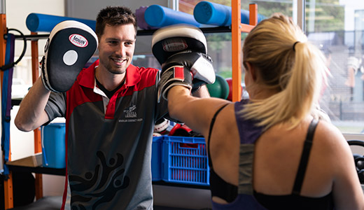 Yarra Leisure Personal Trainer Adam Cooper taking a client through a session