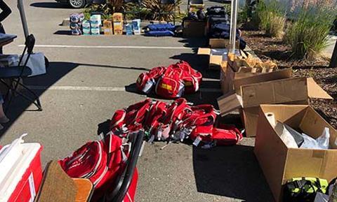 Red backpacks await distribution