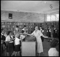 Librarian lending books at Kwinana Public Library, 1959