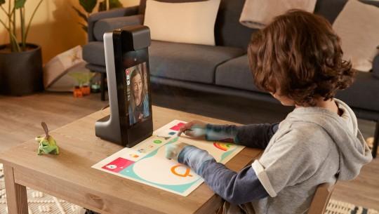 A child uses Amazon's new Amazon Glow device