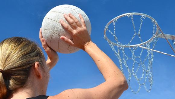 Girl shooting netball