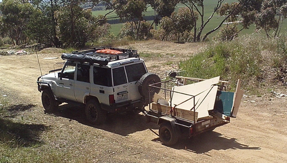 Vehicle with a trailer of waste