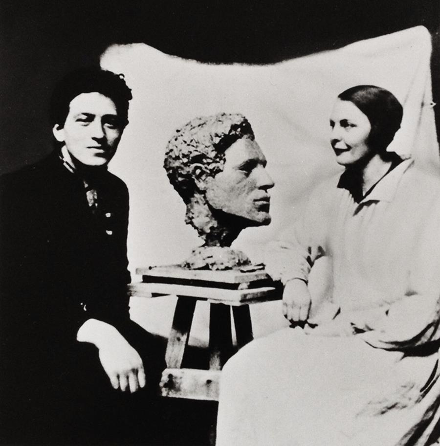 Alberto Giacometti and Flora Mayo with the bust she made of him.