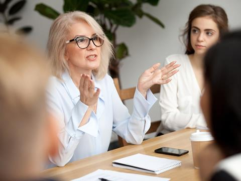 Mature aged woman running a meeting