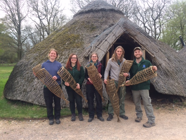 Celtic Harmony group with their hand woven willow fish traps