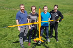Iridium Dynamics CEO Ian Conway Lamb (second from left) with his Halo UAS and team. Credit: Iridium Dynamics
