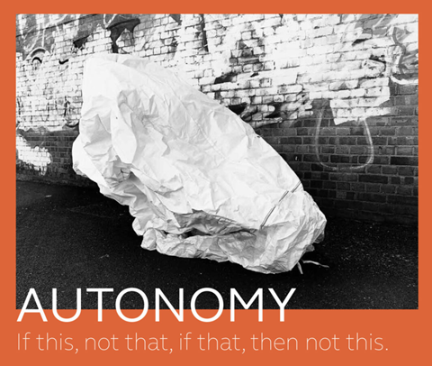 A black and white photo on a bright red background, with the words 'AUTONOMY' and 'If this, not that, if that, then not this.' The photo is a light, crumpled shape in front of a graffitied wall.