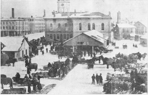 This is a photograph from the Library Archives. It is taken during the 1800's and shows the Guelph Market.