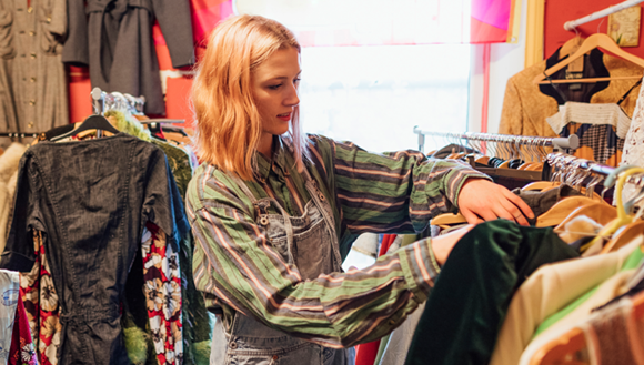 Woman looking through clothes.