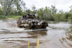 An ASLAV from 2nd Cavalry Regiment conducts a river crossing.