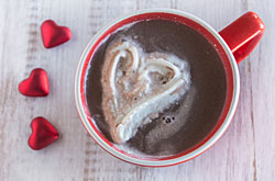 Picture of: Hot cocoa with heart shaped whipped cream.