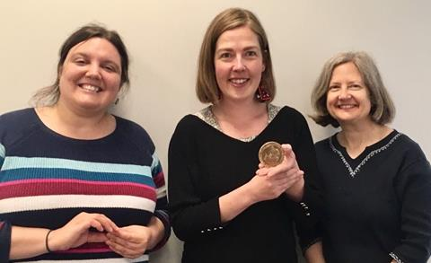 Rebekah Sears, Anna Vogt, Monica Scheifele with Nobel Peace Prize (MCC Photo)