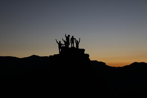 A group of people at the top of a mountain