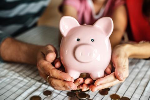 Family holding a piggy bank