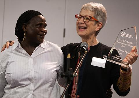 Naomi Tocher (right) with Vanessa (left) receiving the Implementation and Practice Award