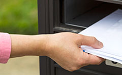 Rates notice being placed in letterbox