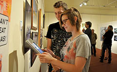 Photo of residents looking at artwork at the Gallery & Museum