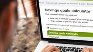 Using savings goals calculator on a laptop