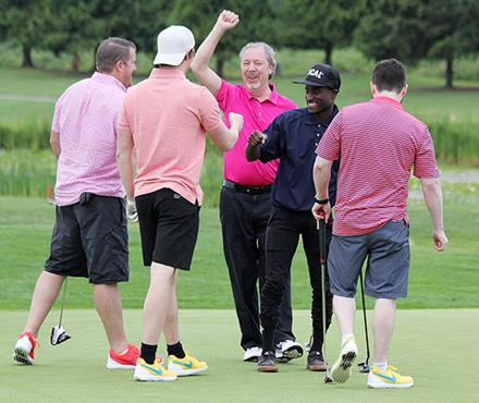 SOBC athlete Malcolm and golfers at the 2016 Goldcorp Invitational