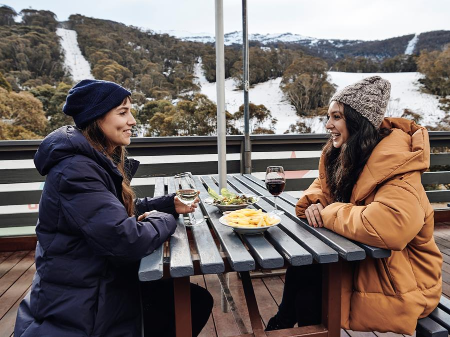 Two women enjoying the view in the Snowy Mountains