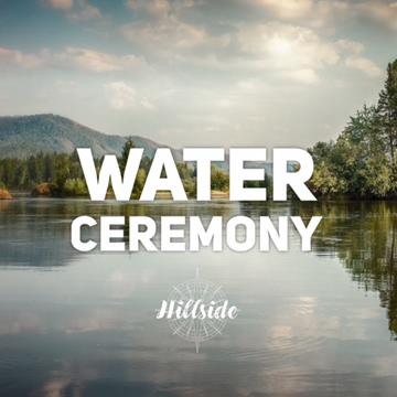 picture of a serene lake with a cloudy sky and treeline in the distance. Words on top of the image read 'water ceremony' with the hillside logo beneath it
