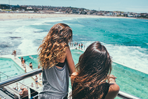 Two teenage girls looking at ocean: No?l Alvarenga - Instagram @noel.alva/Getty Images