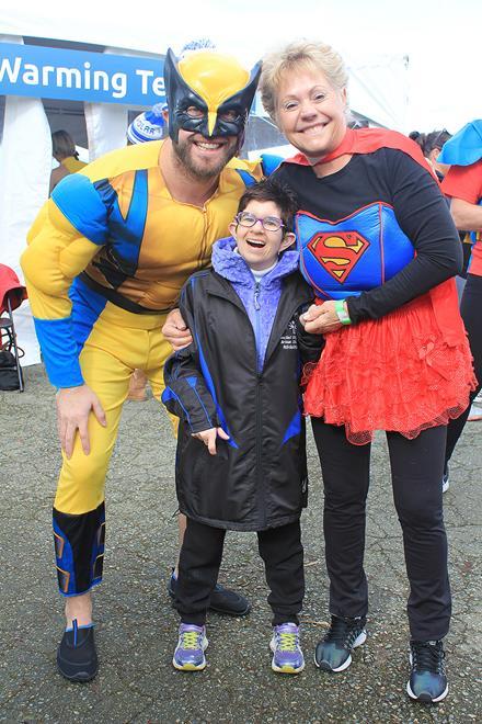 Superhero Polar Plungers Greg and Pam Keith with SOBC athlete Michaela Robinson