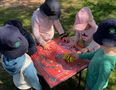 Kids with BeeBot map