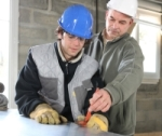Builder with apprentice