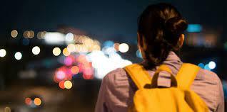 Image of woman walking alone at night