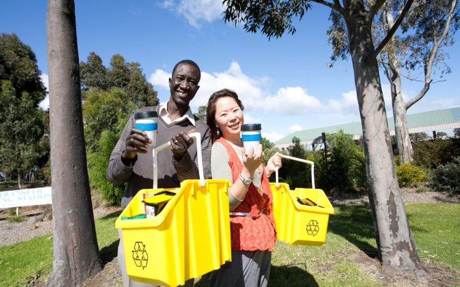 Waste educators holding recycling caddies