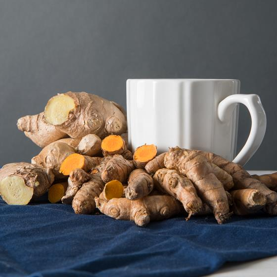 Turmeric, ginger and a coffee cup