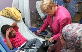 Gro Harlem Brundtland at a hospital in the Middle East