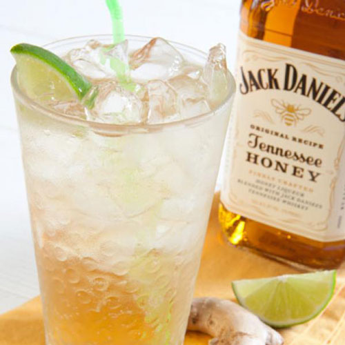 Honey Ginger cocktail and bottle of Jack Daniels