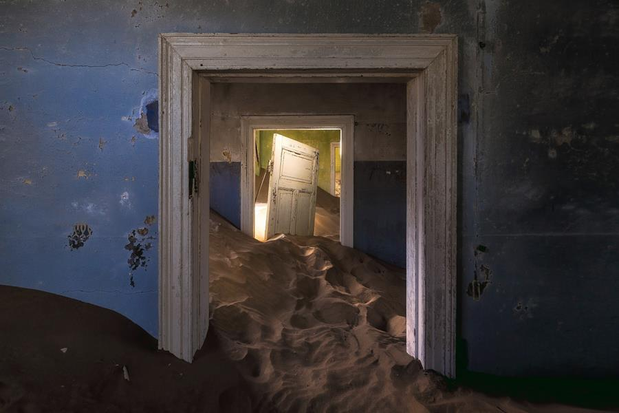 Sand dunes taking over interior of house