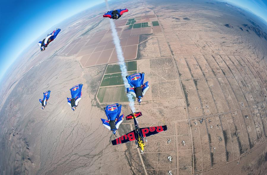 Wingsuit flyers and plane