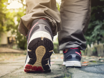 Man walking on trail. © VTT Studio/ Shutterstock.com