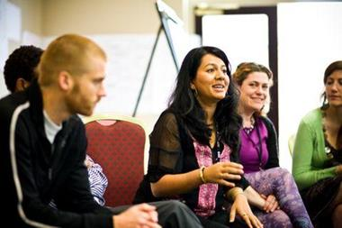 A group of people have a discussion during  a workshop