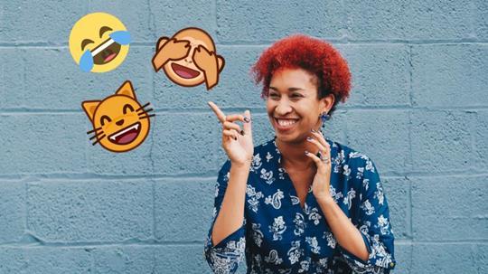 A woman laughing and 3 emojis (laughing) hanging around