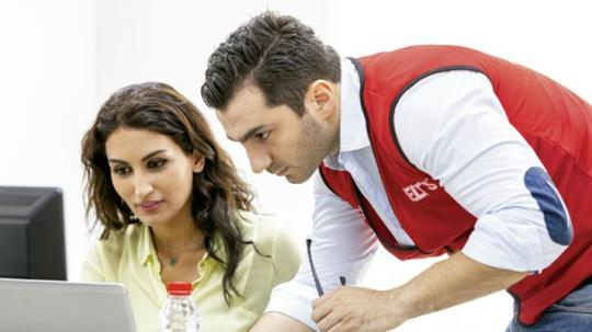 Invigilator and candidate during an computer-delivered IELTS test