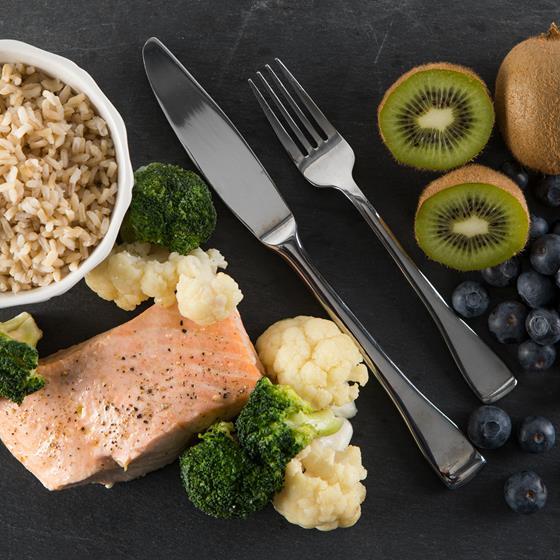 Brown rice, salmon steak, fruits and vegetables