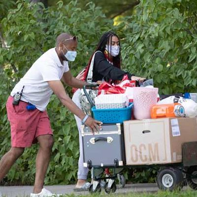 Student and parent with cart during move-in