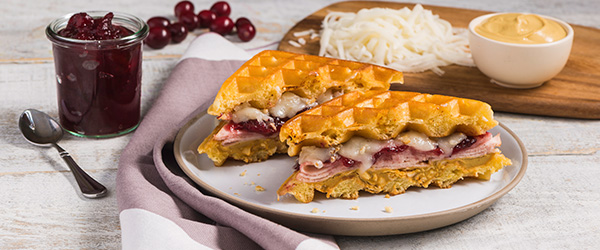Photo of turkey, cranberry, and cheddar cheese waffle sandwich.