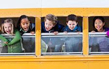 Children Looking Out Of School Bus Window