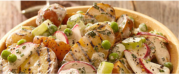 Photo of Bowl of roasted potatoes and radishes with a creamy herb dressing.