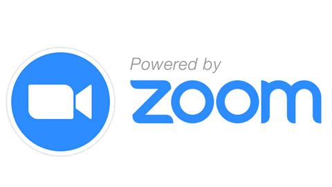 Powered by Zoom logo in sky blue with a white silhouette of a video camera in a blue circle.