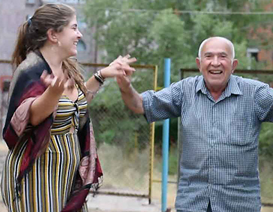 Anoush Baghdassarian with a refugee