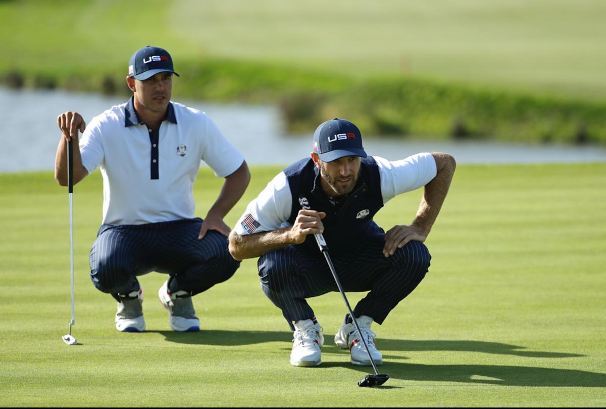 Golfers on putting green