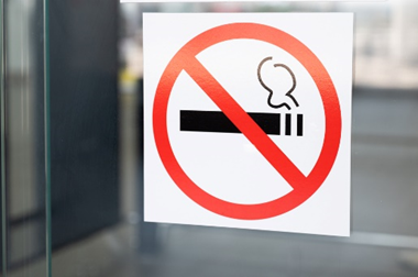 No smoking sign on window of a building